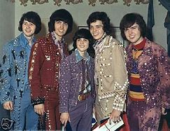 Prince Donald and his brothers in their coloured tabards