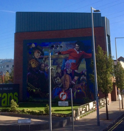 One of the murals with George and other familiar Belfast-born faces
