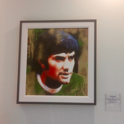 A portrait of footballer George Best inside the airport
