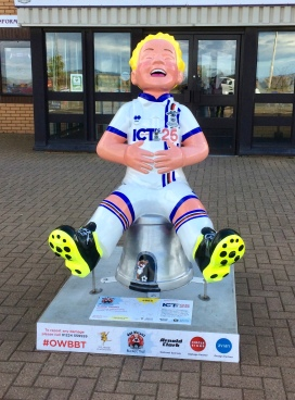 Wullie in front of the local football stadium